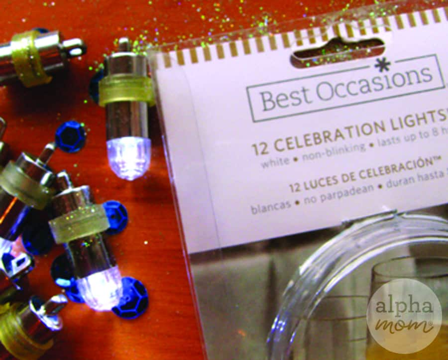close-up photo of supplies for Hanukkah village craft including tiny lights and glitter