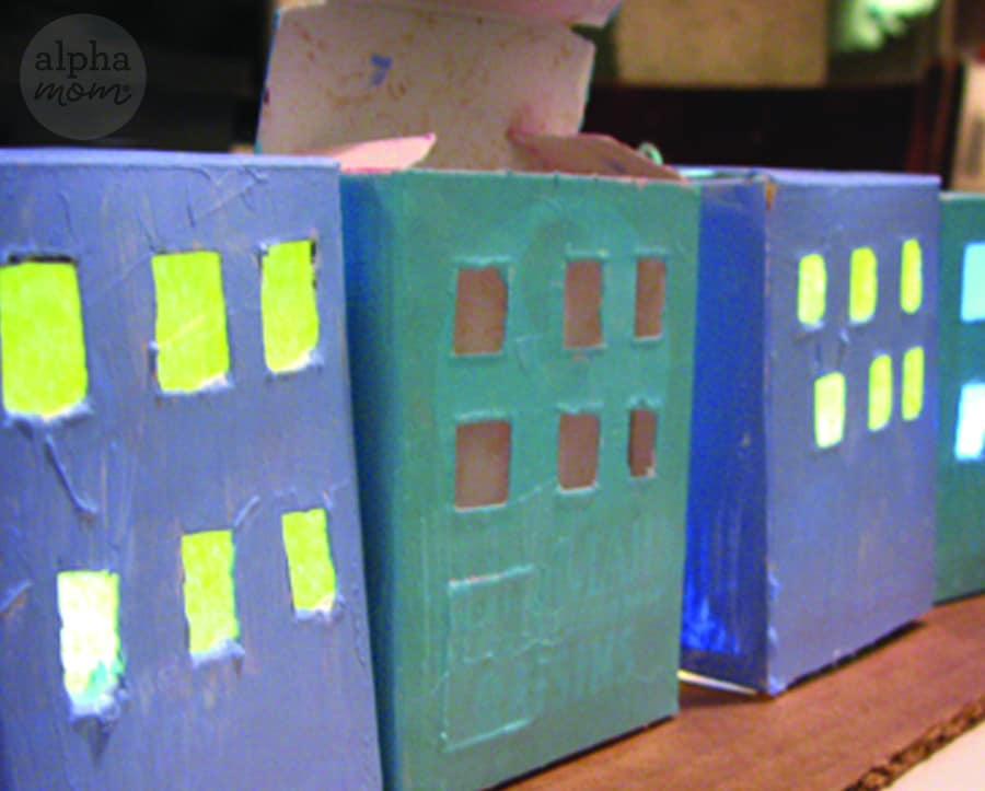 closeup of four different cardboard house in Hanukkah craft while in painting progress